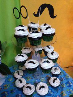 Mustache cupcakes for baby shower by Lauren