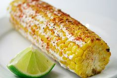 Mexican grilled corn with crema.