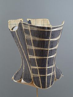 Baleen Corset.  1725 - 1750.   Glazed wool twill, buckram, linen thread, baleen, leather, linen tape, two-ply linen cord wrapped in silk, checked linen plain weave lining.  Philadelphia Museum of Art -