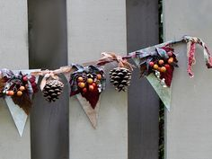 Combine leaves, berries, pinecones, and pieces of quilt to turn a basic garland into a cute display. Get the tutorial at Another Bright Idea. RELATED: 22 Cozy Ways to Decorate Your Home for Fall