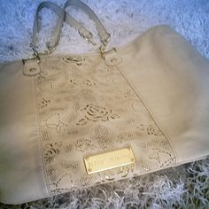 """Betsey Johnson tote * Price Negotiable * No Trades *   Betsey Johnson tote with beautiful laser cut roses panel over gold. Orig $190. As with most of her totes, drop comes with gold tone chain & leather handles. Measures approx 12"""" height,  17.5"""" length and 6"""" depth. Please see picture #4: Corners show wear, the bow is a bit grey on the parts attached to the hardware, could use a cleaning. Despite wear, still sturdy, integrity hasn't been compromised, GUC.  { 15 % off bundles of 2 + listings…"""