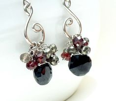 Gorgeous cluster earrings. Love black spinel, garnet, and pyrite.