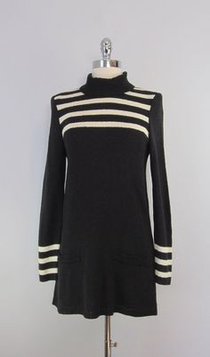 Vintage 1960s knit mod mini dress in black and white.