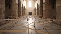 Installation inside an Austrian church comprising motorised wooden seesaws.