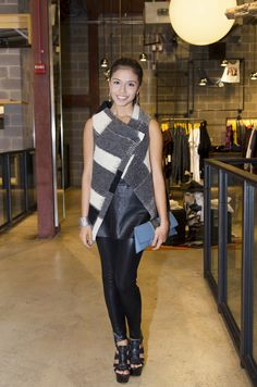 Maria Solis wearing leather leggings and an asymmetrical wool vest during FNO