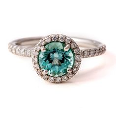 Seafoam tourmaline ring with pave diamond halo and diamond-encrusted band.  Custom design collection at Greenwich Jewelers.