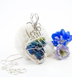 Blue Bismuth crystal pendant necklace  by FeathersnThingz on Etsy