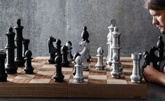 Five to eight inch tall chess pieces made of aluminum. Industrial finish on the light pieces. Darkened metal finish on the dark pieces. Inlaid wood with a stained finish for the board. For all inte...
