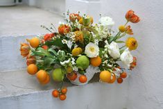 Citrus and Ranunculus...sometimes I think I could do flowers again when I see beautiful arrangements like this.  So inspiring!