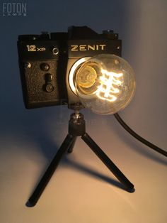 Handcrafted lamp made from a vintage Zenit camera. It comes with a 180 cm long textil cord. Bulb is not included (E27, max 40w, 220V). Dimensions: 28cm x 21 cm x 21cm (approximately).  More lamps: www.fotonlamps.hu