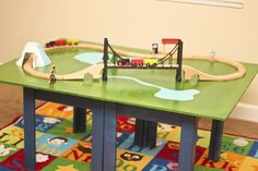 Make a Train Table with Plywood and a Coffee Table! Make a train table using plywood and a coffee ta Model Training, Train Table, Wooden Train, Model Train Layouts, Train Set, Models, Classic Toys, Diy Table, Kids Furniture