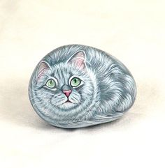 Beautiful hand painted kitty.  It is a smooth beach pebble, hand painted using acrylics and sealed with a matt protective finish.  It measures 3,5