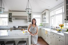 Cape Cod Decorating Ideas For The Kitchen white cupboards steel lanterns white marble