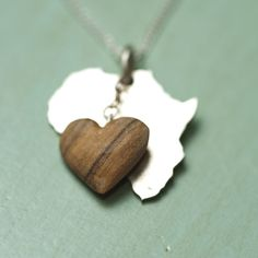 Silver Africa pendant with a dangling olive wood heart by Natasha Wood Jewellery