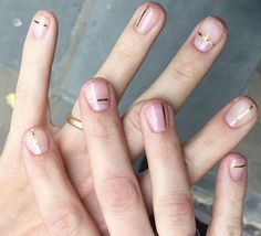 Adorn naked nails with a single strip of gold ribbon for a look that oozes catwalk cool.
