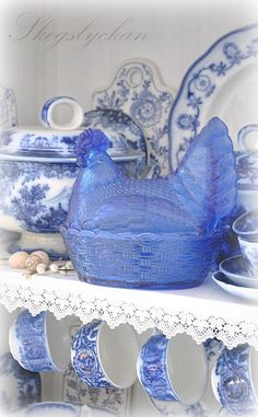 Charming collection of Blue and White pottery and blue glass.