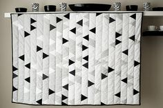 triangle quilt in white, pale grey and stark black. awesome.