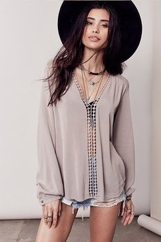 - Feminine and sexy long sleeve blouse with crochet inset. 100% Rayon Model is…