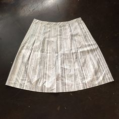 "50% off Bundles! Loft Silver Stripe A-Line Skirt Limited Time- 50% off Bundles of 3 or More! Ask me to create your bundle. Loft Silver Stripe A-Line Skirt. Silver on top of light khaki base. Size 14 Petite measures flat: 18"" around top, 27"" hips, 25"" long. Hidden side zipper. 100% cotton and fully lined. 0518/250/0521 LOFT Skirts A-Line or Full"