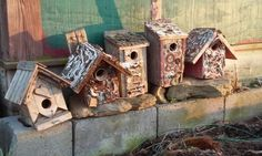 Old junk covered birdhouses.