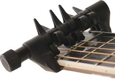 The spider capo, the most versatile capo ever developed. Music Guitar, Cool Guitar, Guitar Lessons For Beginners, Guitar Gifts, Guitar Accessories, 21st Gifts, Wonderwall, Wine Rack, Creative