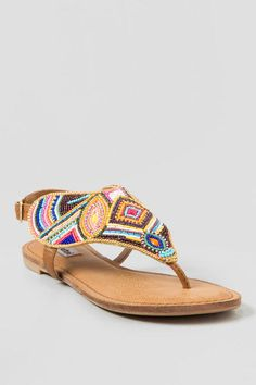 The Not Rated,Mariachi Beaded Sandal is a fiesta on your feet. These gorgeous sandals feature varying colorful beads with a chain boarder for detail. Pair the Not Rated, Mariachi Beaded Sandas with a fringe cross body and a crochet crop top for a festival ready look. Maurice's