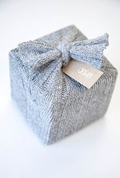 boxwoodclippings cozy gift wrap using a sweater. #HolidaySavings