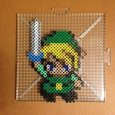 Link perler beads by katanapapi Perler Bead Mario, Diy Perler Beads, Pixel Beads, Fuse Beads, Pearler Bead Patterns, Perler Patterns, Nerd Crafts, Iron Beads, Zelda Birthday