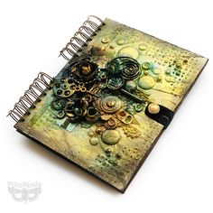 Anna Dabrowska aka Finnabair mixed media journal covered with embellishments from her Mechanicals collection with Prima
