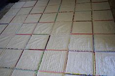 """A different quilt as you go tutorial by Diary of a Flutter Kat.  Not something I do for a show quilt, but would work well for charity lap throws and the like. Also, I would not use for blocks bigger than about 6"""".  But, I love the concept."""