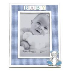 The 4 x 6 Gingham Bear Picture Frame from Reed & Barton is adorable with its puffed baby blue and white gingham fabric accented with silverplate and B-A-B-Y spelled in soft enamel colors. Sitting quietly in the corner and keeping baby company is a huggable 3-dimensional bear with a sweet bow tie and baby blue enameled ears and feet.