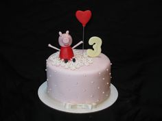 Peppa Pig inspired cake for a girl's 3rd birthday.  Peppa Pig was hand crafted with fondant