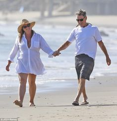 Crazy in love: Pierce Brosnan and wife Keely Shaye Smith put on a loving display as they w...