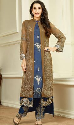 Complement your gorgeous outfit as Karisma Kapoor with this blue and brown color georgette embroidered pant style suit. The ethnic lace and resham work to your attire adds a sign of beauty statement for the look. #embroideredpantstylesuit #kotystyledresses #bollywoodsuitdesign