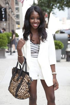 Nneya Richards, PR and stylist, wearing Kate Moss for Topshop Tuxedo Blazer and shorts, Topshop striped tanktop, Invicta watch, Cartier bracelet, Me  Ro jewelry, and Celine bag.