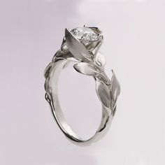 A handmade platinum leaves ring set with a large, clear diamond. This ring is set with a 1ct clear diamond but can be set with any stone you choose,