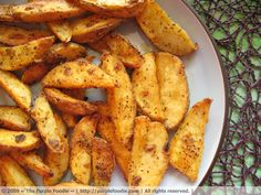 Crispy Golden Fries!! I'm never going to make garlic potato fries any other way.... incredibly simple to make and are so full of flavor!! They were Gobbled down as soon as they were out of the oven.