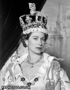 A portrait of Queen Elizabeth II in the Imperial State crown in Buckingham Palace, after her Coronation at Westminster Abbey.