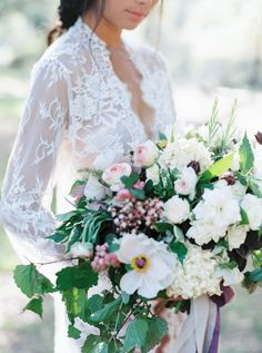 Between the breathtaking V neck lace wedding dress and the elegant, organic blooms, we can't stop staring at this stunning shoot!  #bridalbouquets #bouquetwedding #weddingflower #gardenwedding #weddingflorals #flowerloversdaily #flowerwedding #gardenweddings         #makehappymemories #weddingspo #mykonoswedding #eventdesigns #weddingday #weddingblog #modernwedding #weddingdecorations #elegantwedding #weddingluxury #weddingdetail #weddingtrend #eventdesigners #brideday