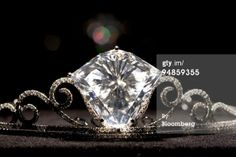 Tiara with a shield-shaped diamond weighing 101.27 carats, set in brilliant-cut diamond extending scrolls, mounted in 18k white gold. Sold for $6.2 million at in 2008. The diamond is from the same mine as the Cullinan, via christies.com/.