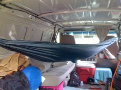 (Today we have a guest post by a reader who has something very unusual in his van. There isn't a bed, he sleeps in a Hammock!) My van conversion was very easy. I simply HATE vans that are full of … Van Conversion: Sleeping in a Hammock in a Van Read Camper Life, Diy Camper, Camper Van, Campers, Camper Ideas, Truck Camping, Van Camping, Vw T5, Station Wagon