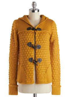 I'd like to have fun with this lovely cardigan. I'd pair it with a short black skirt, black tights and black Chuck Taylors.