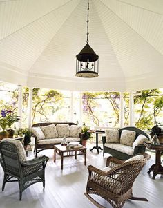 """The Ultimate Covered Porch - This covered porch has a mix of antique wicker; the fabric is """"lemonade- and sangria-proof,"""" says designer Robin Bell. Because who wants to clean up a mess after a relaxing afternoon?"""