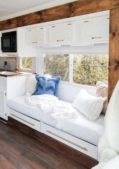 Tour this remodeled RV filled with lots of white, shiplap, and warm wood tones from Featured. Rv Living, Tiny Living, Mobile Living, Caravan Living, Living Vintage, Rv Interior, Vintage Camper Interior, Trailer Interior, Remodeled Campers