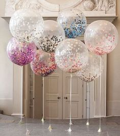 How fun are these fancy balloons for a bridal shower or bachelorette? We're eyeing the hot pink one on the left! #weddingtricks