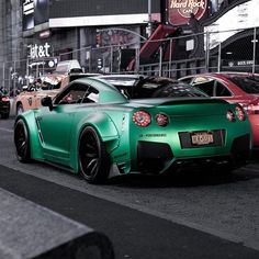 Nissan GT-R. Looks nice but not sure about the green :/ Nissan Gtr Nismo, Nissan Gt R, Nissan Skyline Gtr, Gtr R35, Ferrari Laferrari, Ferrari Car, Nissan Kicks, Austin Cars, Tuner Cars