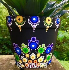 This pattern was created on a 5 cm) diameter clay pot using our set of 7 dotting tools. Flower Pot Art, Flower Pot Design, Clay Flower Pots, Flower Pot Crafts, Clay Pot Crafts, Rock Crafts, Dot Art Painting, Mandala Painting, Pottery Painting
