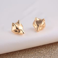 These gold fox stud earrings make the perfect gift for any foxy lady you know! Each gold fox is hand finished and the fine detailing on the face of the fox gives it a sophisticated edge. All...
