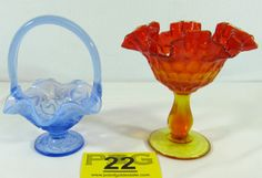 Lot 22 in the 12.3.13. online & auction! Beautiful pair of vintage handmade colorful and decorative Amberina and Blue Opal Fenton Art Glass wares with ruffled edge. Heavily influenced by Tiffany and Steuben; Fenton was the 1st to introduce many of the vibrant colors including Carnival glass. #Home #Decor #Collectible #POGAuctions