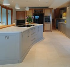kitchen, bespoke curved island with lift up extractor, twin ovens either side of the fridge contact wolfe kitchens for further information